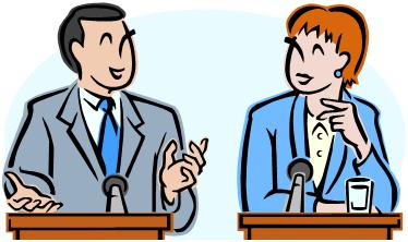 Two debaters at podiums smile at one another
